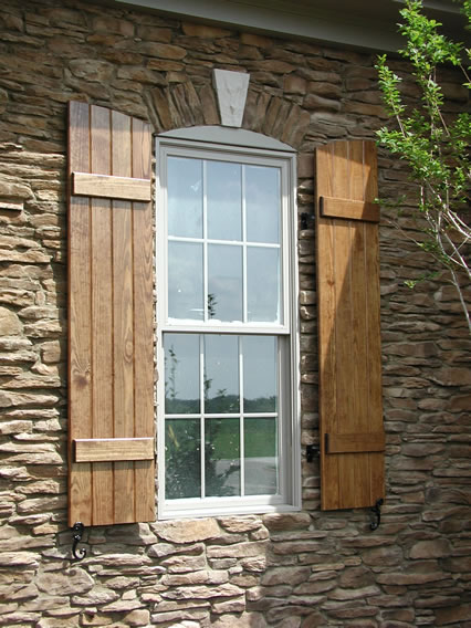 Board And Batten Shutter With Arch Top   Closed  Stained